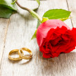Two golden rings and red rose — Stock Photo #41048307