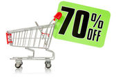 Shopping cart with green sale tag — Stock Photo