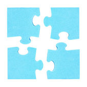 Four  puzzle pieces combined cooperation concept — Stock Photo