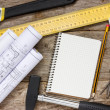 Technical drawing and tools with blank notebook — Stock Photo