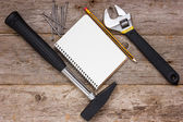 Construction tools and blank notebook — ストック写真