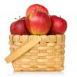Wooden basket full of red apples — Stock Photo