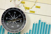 Economic growth charts and compass — Stock Photo