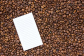 List on the background coffee beans  — Stock Photo