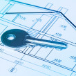 Key on blueprint of new house — Stok fotoğraf