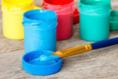 Blue watercolor paints with paintbrush — Stock Photo