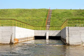 Floodgates of a small dam — Stock Photo