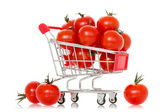 Shopping cart full of tomatoes — Stock Photo