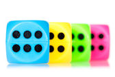 Colorful dice aligned — Stock Photo