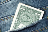 One dollar note in the jeans pocket — Stock Photo