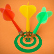 Three darts hitting green target — Stock Photo #48690009