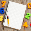 Colorful numbers and empty notebook — Stock Photo #48851261