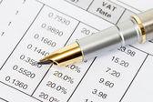 Ink pen on invoice document — Stock Photo