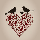 Bird on heart — Stockvector