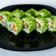 Sushi with green caviar on a plate. — Stock Photo
