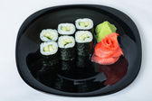 Sushi with cucumber on a plate. — Foto de Stock