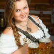 Foto Stock: Girl holds two beer