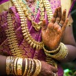 Hands of Indibride adorned with jewelery, bangles and painted with henna — Stock Photo #35732893
