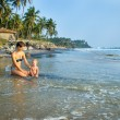 Happy family resting at tropical beach — Stock Photo #37745917