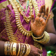 Hands of Indibride adorned with jewelery, bangles and painted with henna — Stock Photo #37747921