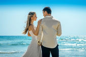 Bride and groom standing alone — Stockfoto