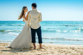 Bride and groom standing alone — Stock Photo