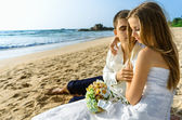 Bride and groom embracing on the ocean — Stock Photo