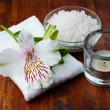 White towel, aromatic salt and flower — Stock Photo