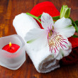 Red and white towels, aromatic salt and flower — Stock Photo