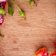 Multicolored roses on a wooden board — Stock Photo