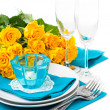 Table setting with yellow roses — Stock Photo