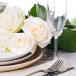 Table setting with beige roses — Stock Photo