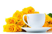 Roses and white coffee cup — Stock Photo
