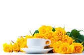 Yellow roses and white coffee cup — Stock Photo