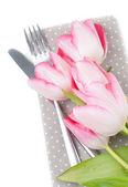 Pink spring tulips, fork and knife — Stock Photo