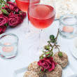Stock Photo: Two glasses of rose wine , fresh flowers, cakes