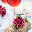 Stock Photo: Walnut-chocolate cakes, flowers and rose wine