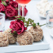 Walnut-chocolate cakes, flowers and rose wine — Stock Photo #18865347