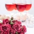 Roses and several glasses of rose wine — Stock Photo #18865401