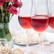 Stock Photo: Rose wine in glasses, home party