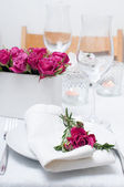 Festive dining table setting with pink roses — Stock Photo