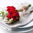 Table setting with red roses, napkins and vintage crockery — Stock Photo #19131927