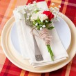 Festive table setting with flowers and vintage crockery - Stock Photo