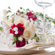 Table setting with roses in bright colors and vintage crockery — Stock Photo #19132491