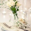 Table setting with roses in bright colors and vintage crockery — Stock Photo #19132677