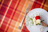 Festive table setting with flowers and vintage crockery — Stock Photo