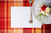 Festive table setting with flowers and vintage crockery, card te — Stock Photo
