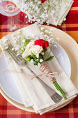 Festive table setting with flowers and vintage crockery, closeup — Stock Photo
