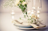 Table setting with roses in bright colors and vintage crockery — Stock Photo