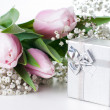 Tulips and a gift box - Stock Photo